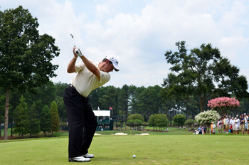 JOHNS CREEK, GA - AUGUST 09:  Lee Westwood of England hits a tee shot during a practice round prior to the start of the 93rd PGA Championship at the Atlanta Athletic Club on August 9, 2011 in Johns Creek, Georgia.  (Photo by Stuart Franklin/Getty Images)