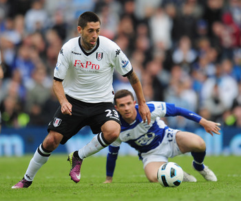BIRMINGHAM, ENGLAND - MAY 15:  Clint Dempsey of Fulham breaks away from Barry Ferguson of Birmingham City during the Barclays Premier League match between Birmingham City and Fulham at St. Andrews on May 15, 2011 in Birmingham, England.  (Photo by Shaun B