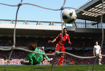 LIVERPOOL, ENGLAND - MAY 01:  Luis Suarez of Liverpool scores the third goal during the Barclays Premier League match between Liverpool  and Newcastle United at Anfield on May 1, 2011 in Liverpool, England.  (Photo by Clive Brunskill/Getty Images)