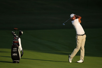 JOHNS CREEK, GA - AUGUST 09: Adam Scott of Australia hits an approach shot during a practice round prior to the start of the 93rd PGA Championship at the Atlanta Athletic Club on August 9, 2011 in Johns Creek, Georgia.  (Photo by Andrew Redington/Getty Im