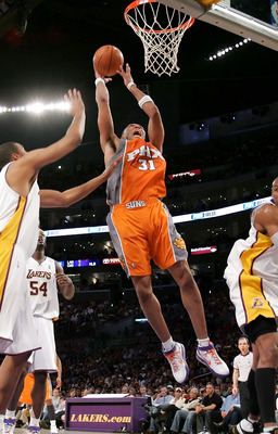 LOS ANGELES - APRIL 29:  Shawn Marion #31 of the Phoenix Suns goes up for a shot over Maurice Evans #6 and Brian Cook #43 of the Los Angeles Lakers in Game Four of the Western Conference Quarterfinals during the 2007 NBA Playoff at Staples Center on April
