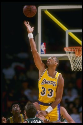 Nov 1987:  Center Kareem Abdul-Jabbar of the Los Angeles Lakers goes up for the ball during a game against the Milwaukee Bucks at the Great Western Forum in Inglewood, California. Mandatory Credit: Mike Powell  /Allsport Mandatory Credit: Mike Powell  /Al