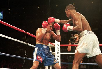 18 Sep 1999:  Oscar De La Hoya ducks a punch from Felix Trinidad during the welterweight title fight at the Mandalay Bay Casino in Las Vegas, Nevada. Trinidad won the fight by decision. Mandatory Credit: Al Bello  /Allsport