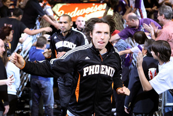 PHOENIX, AZ - APRIL 13:  Steve Nash #13 of the Phoenix Suns runs out onto the court for warm ups to the NBA game against the San Antonio Spurs at US Airways Center on April 13, 2011 in Phoenix, Arizona.  NOTE TO USER: User expressly acknowledges and agree