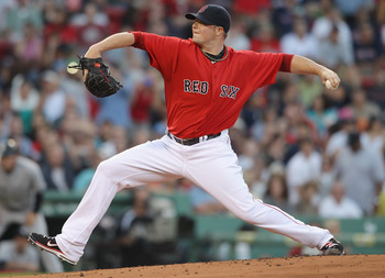 BOSTON, MA - AUGUST 05:  Jon Lester #31 of the Boston Red Sox delivers a pitch in the first inning against the New York Yankees on August 5, 2011 at Fenway Park in Boston, Massachusetts.  (Photo by Elsa/Getty Images)