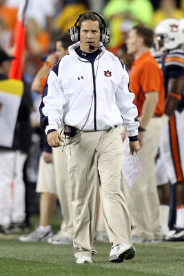 GLENDALE, AZ - JANUARY 10:  Head coach Gene Chizik of the Auburn Tigers walks the sidelines during the Tostitos BCS National Championship Game against the Oregon Ducks at University of Phoenix Stadium on January 10, 2011 in Glendale, Arizona.  (Photo by C