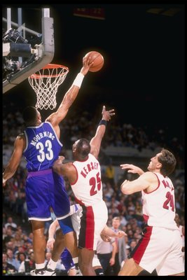 2 Mar 1995:  Center Alonzo Mourning of the Charlotte Hornets blocks the shot of a Portland Trail Blazers player during a game at the Rose Garden in Portland, Oregon.  The Hornets won the game, 109-99. Mandatory Credit: Otto Greule  /Allsport