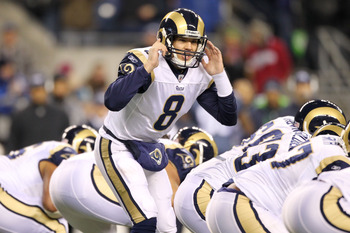 SEATTLE, WA - JANUARY 02:  Quarterback Sam Bradford #8 of the St. Louis Rams signals to his teammates during their game against the Seattle Seahawks at Qwest Field on January 2, 2011 in Seattle, Washington.  (Photo by Otto Greule Jr/Getty Images)