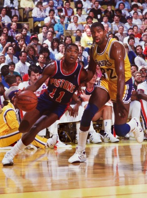 1987:  ISIAH THOMAS OF THE DETROIT PISTONS DRIVES PAST MAGIC JOHNSON OF THE LAKERS. Mandatory Credit: Rick Stewart/ALLSPORT