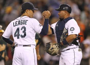 SEATTLE - AUGUST 02:  Closing pitcher Brandon League #43 of the Seattle Mariners celebrates with catcher Miguel Olivo #30 after defeating the Oakland Athletics 4-2 at Safeco Field on August 2, 2011 in Seattle, Washington. (Photo by Otto Greule Jr/Getty Im