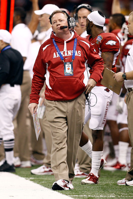 NEW ORLEANS, LA - JANUARY 04:  Head coach Bobby Petrino of the Arkansas Razorbacks reacts in the first quarter against the Ohio State Buckeyes during the Allstate Sugar Bowl at the Louisiana Superdome on January 4, 2011 in New Orleans, Louisiana.  (Photo