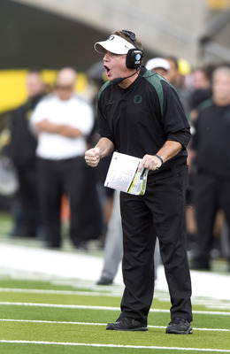 EUGENE, OR - NOVEMBER 06: Head coach Chip Kelly of the Oregon Ducks yells out to his team in the second quarter of the game against the Washington Huskies at Autzen Stadium on November 6, 2010 in Eugene, Oregon. The Ducks won the game 53-16. (Photo by Ste