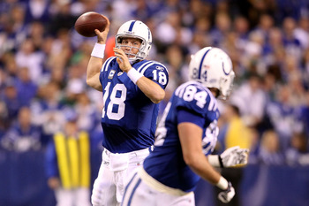 INDIANAPOLIS, IN - JANUARY 08:  Peyton Manning #18 of the Indianapolis Colts attempts to pass the ball to Jacob Tamme #84 against the New York Jets during their 2011 AFC wild card playoff game at Lucas Oil Stadium on January 8, 2011 in Indianapolis, India