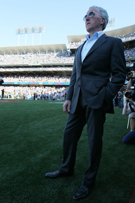 LOS ANGELES, CA - MARCH 31:  Los Angeles Dodgers owner Frank McCourt stands on the field prior to their Opening Day game against the San Francisco Giants at Dodger Stadium on March 31, 2011 in Los Angeles, California.  (Photo by Jeff Gross/Getty Images)
