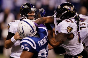 INDIANAPOLIS - JANUARY 16:  Quarterback Joe Flacco #5 of the Baltimore Ravens is rushed by Dwight Freeney #93 of the Indianapolis Colts in the AFC Divisional Playoff Game at Lucas Oli Stadium on January 16, 2010 in Indianapolis, Indiana.  (Photo by Jonath