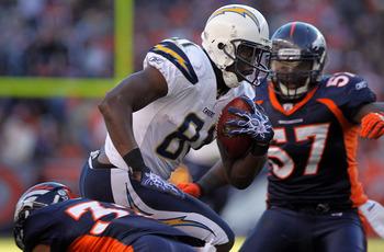 DENVER - JANUARY 02:  Wide receiver Randy McMichael #81 of the San Diego Chargers makes a 17 yard first down reception as linebacker Mario Haggan #57 of the Denver Broncos moves in for the tackle at INVESCO Field at Mile High on January 2, 2011 in Denver,