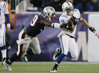 FOXBORO, MA - NOVEMBER 21:  Austin Collie #17 of the Indianapolis Colts tries to get around Mike Wright #99 of the New England Patriots on November 21, 2010 at Gillette Stadium in Foxboro, Massachusetts. The Patriots defeated the Colts 31-28. (Photo by El