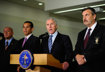 LOS ANGELES, CA - APRIL 08:  Los Angeles Dodgers owner Frank McCourt (2nd-R)speaks as Los Angeles Police Department Chief Charlie Beck (R) Los Angeles Mayor Antonio Villaraigosa (2nd-L) and Councilman Ed Reyes (L) look on, during a Dodger Stadium security