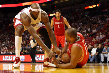 MIAMI, FL - MARCH 27: Center Erick Dampier #25 of the Miami Heat defends against Center Chuck Hayes #44 of the Houston Rockets  at American Airlines Arena on March 27, 2011 in Miami, Florida. NOTE TO USER: User expressly acknowledges and agrees that, by d