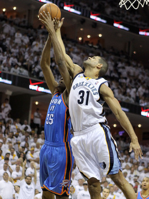 MEMPHIS, TN - MAY 07:  Kevin Durant #35 of the Oklahoma City Thunder and Shane Battier #31 of the Memphis Grizzlies reach for a rebound in Game Three of the Western Conference Semifinals in the 2011 NBA Playoffs at FedExForum on May 7, 2011 in Memphis, Te