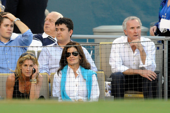 LOS ANGELES, CA - OCTOBER 15:  Owner Frank McCourt, far rignt, and wife and Dodgers president, Jamie McCourt, far left, of the Los Angeles Dodgers take their separate seats during Game One of the NLCS agianst the Philadelphia Phillies during the 2009 MLB