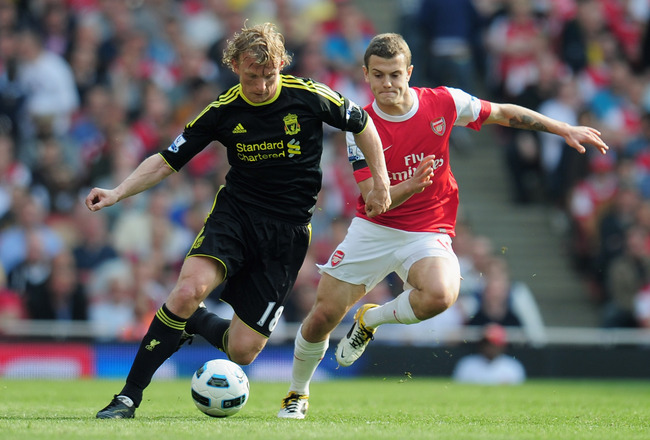 LONDON, ENGLAND - APRIL 17:  Dirk Kuyt of Liverpool is closed down by Jack Wilshere of Arsenal during the Barclays Premier League match between Arsenal and Liverpool at the Emirates Stadium on April 17, 2011 in London, England.  (Photo by Shaun Botterill/
