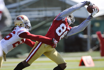 SANTA CLARA, CA - JULY 30: Ronald Johnson #88 of the San Francisco 49ers catches a pass over Tramaine Brock #26 during practice at the San Francisco 49ers training facility on July 30, 2011 in Santa Clara, California. (Photo by Thearon W. Henderson/Getty