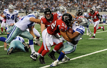ARLINGTON, TX - OCTOBER 25:  Kickoff return specialist Allen Rossum #30 of the Dallas Cowboys is tackled by Coy Wire #52 of the Atlanta Falcons at Cowboys Stadium on October 25, 2009 in Arlington, Texas.  (Photo by Ronald Martinez/Getty Images)