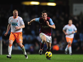 BIRMINGHAM, ENGLAND - NOVEMBER 10:  Ciaran Clark of Aston Villa breaks forward with the ball during the Barclays Premier League match between Aston Villa and Blackpool at Villa Park on November 10, 2010 in Birmingham, England.  (Photo by Shaun Botterill/G
