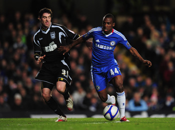LONDON, ENGLAND - JANUARY 09:  Gael Kakuta of Chelsea holds off Mark Kennedy of Ipswich Town during the FA Cup sponsored by E.ON 3rd round match between Chelsea and Ipswich Town at Stamford Bridge on January 9, 2011 in London, England.  (Photo by Shaun Bo