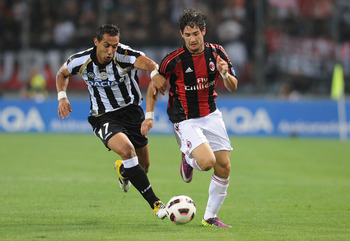 UDINE, ITALY - MAY 22:  Amine Benatia of Udinese (L) and Alexandre Pato of AC Milan compete for the ball during the Serie A match between Udinese Calcio and AC Milan  at Stadio Friuli on May 22, 2011 in Udine, Italy.  (Photo by Dino Panato/Getty Images)