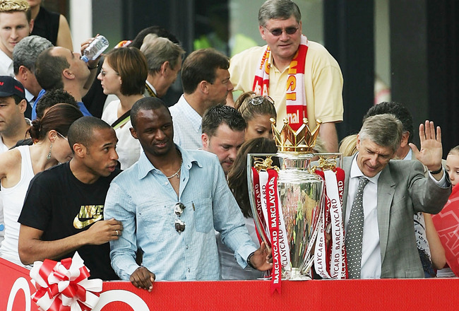 LONDON - MAY 16:  Thierry Henry (L-R), Patrick Vieira and Arsene Wenger are seen at the front of the bus outside the Islington Town Hall during the Arsenal Football Club victory parade to show the League Champions with their FA Barclaycard Premiership Tro