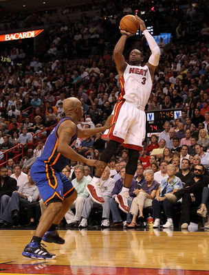 MIAMI, FL - FEBRUARY 27:  Dwyane Wade #3 of the Miami Heat shoots over Chauncey Billups #4 of the New York Knicks makes a big shot during a game  at American Airlines Arena on February 27, 2011 in Miami, Florida. NOTE TO USER: User expressly acknowledges
