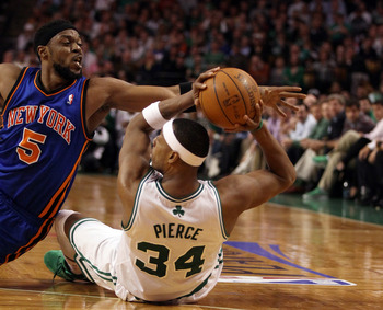 BOSTON, MA - APRIL 19:  Paul Pierce #34 of the Boston Celtics hangs on to the loose ball as Bill Walker #5 of the New York Knicks defends in Game Two of the Eastern Conference Quarterfinals in the 2011 NBA Playoffs on April 19, 2011 at the TD Garden in Bo