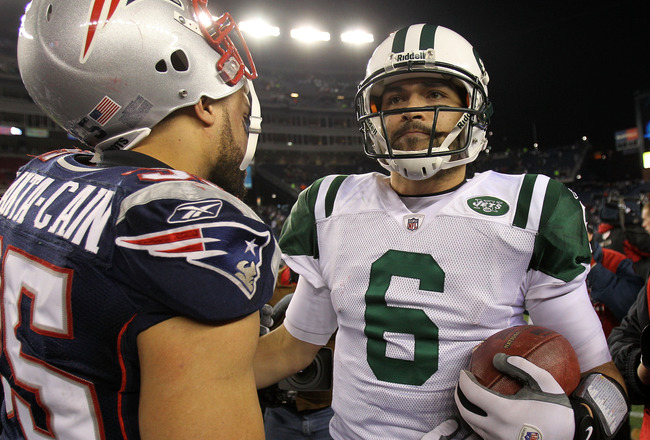 FOXBORO, MA - JANUARY 16:  Quarterback Mark Sanchez #6 of the New York Jets speaks with Tully Banta-Cain #95 of the New England Patriots after their 2011 AFC divisional playoff game at Gillette Stadium on January 16, 2011 in Foxboro, Massachusetts.  (Phot