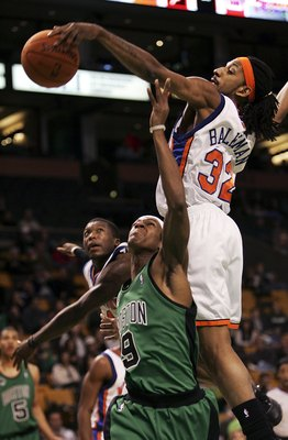 BOSTON - NOVEMBER 24:  Rajon Rondo #9 of the Boston Celtics is fouled by Renaldo Balkman #32 of the New York Knicks on November 24, 2006 at the TD Banknorth Garden in Boston, Massachusetts. The New York Knicks defeated the Boston Celtics 101-77. NOTE TO U
