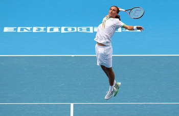 MELBOURNE, AUSTRALIA - JANUARY 26:  Alexandr Dolgopolov of the Ukraine plays a smash in his quarterfinal match against Andy Murray of Great Britain during day ten of the 2011 Australian Open at Melbourne Park on January 26, 2011 in Melbourne, Australia.