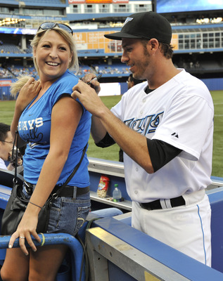 TORONTO, CANADA - JULY 26:  J.P. Arencibia #9 of the Toronto Blue Jays looks signs autographs prior to MLB game action against the Baltimore Orioles July 26, 2011 at Rogers Centre in Toronto, Ontario, Canada. (Photo by Brad White/Getty Images)