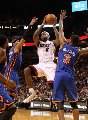 MIAMI, FL - FEBRUARY 27:  LeBron James #6 of the Miami Heat is guarded by Carmelo Anthony #7 and Shawne Williams #3 of the New York Knicks looks on during a game at American Airlines Arena on February 27, 2011 in Miami, Florida. NOTE TO USER: User express
