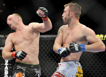 LAS VEGAS - NOVEMBER 21: Brock Larson (L) battles Brian Foster (R) during their Welterweight Fight at the UFC 106 at Mandalay Bay Events Center on November 21, 2009 in Las Vegas, Nevada. (Photo by Jon Kopaloff/Getty Images)
