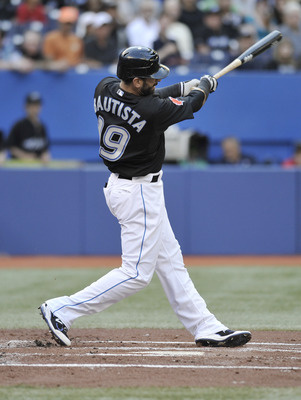 TORONTO, CANADA - AUGUST 9:  Jose Bautista #19 of the Toronto Blue Jays bats during MLB game action against the Oakland Athletics August 9, 2011 at Rogers Centre in Toronto, Ontario, Canada. (Photo by Brad White/Getty Images)
