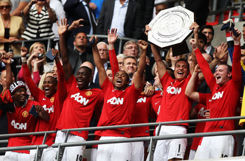 LONDON, ENGLAND - AUGUST 07:  Nemanja Vidic of Manchester United lifts the Community Shield after victory in the FA Community Shield match sponsored by McDonald's between Manchester City and Manchester United at Wembley Stadium on August 7, 2011 in London