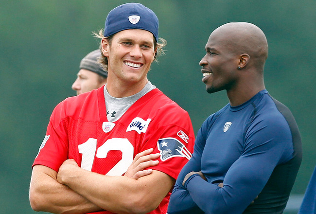 FOXBOROUGH, MA  - JULY 29:  Tom Brady #12 and Chad Ochocinco of the New England Patriots chat during training camp at Gillette Stadium on July 29, 2011 in Foxborough, Massachusetts.  (Photo by Jim Rogash/Getty Images)