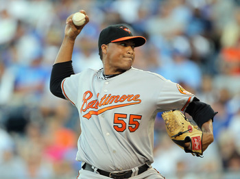KANSAS CITY, MO - AUGUST 02:  Starting pitcher Alfredo Simon #55 of the Baltimore Orioles pitches during the 1st inning of the game on August 2, 2011 at Kauffman Stadium in Kansas City, Missouri.  (Photo by Jamie Squire/Getty Images)
