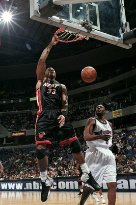 12 Nov 1999:  Alonzo Mourning #33 of the Miami Heat slam dunks the ball as Isaac Austin #8 of the Washington Wizards watches him during the game at the MCI Center in Washington, D.C. The Heat defeated the Wizards 104-95.   Mandatory Credit: Doug Pensinger