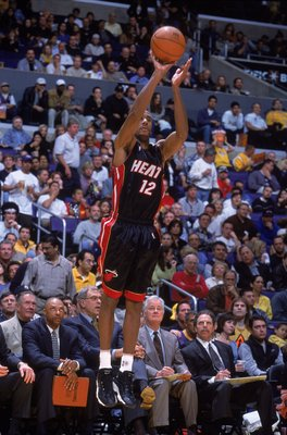 21 Jan 2001:  Bruce Bowen #12 of the Miami Heat jumps to shoot the ball during the game against the Los Angeles Lakers at the STAPLES Center in Los Angeles, California. The Heat defeated the Lakers 103-92.    NOTE TO USER: It is expressly understood that