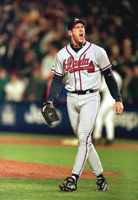 15 Oct 1999: Relief pitcher John Rocker #49 of the Atlanta Braves celebrates as he walks off the field during Game 3 of the National League Championship Series against the New York Mets at Shea Stadium in New York. The Braves defeated the Mets 1-0.