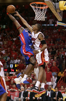 MIAMI - JUNE 6:  Ben Wallace #3 of the Detroit Pistons drives for a dunk attempt against Rasual Butler #45 of the Miami Heat in Game Seven of the Eastern Conference Finals during the 2005 NBA Playoffs June 6, 2005 at the American Airlines Arena in Miami,