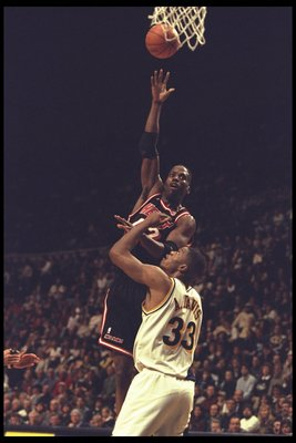 28 Dec 1995:  Kevin Willis of the Miami Heat takes a shot against forward Antonio Davis of the Indiana Pacers during a game played at Market Square Arena in Indianapolis, Indiana.  The Pacers won the game, 91-77. Mandatory Credit: ALLSPORT USA  /Allsport