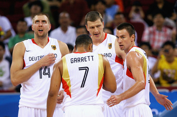 BEIJING - AUGUST 14: Dirk Nowitzki #14 of Germany and his team mates look on during the Men's Preliminary Round Group B  basketball game against Spain at the Olympic Basketball Gymnasium during day 6 of the Beijing 2008 Olympic Games on August 14, 2008 in